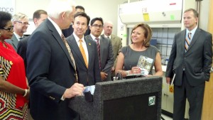 Rodney Herrington CEO of Aqua Research presents NM Gov Martinez with her personal H2gO Purifier
